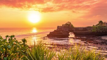 Tanah lot temple bali and rocky formation at the golden 10 scaled