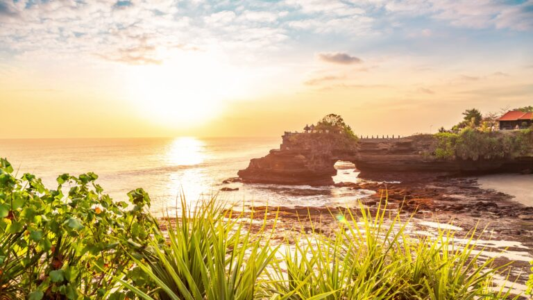 Tanah lot temple bali and rocky formation at the golden 4 scaled