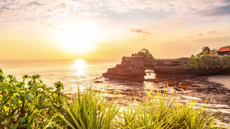 Tanah lot temple bali and rocky formation at the golden 5 scaled