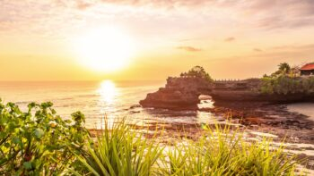 Tanah lot temple bali and rocky formation at the golden 6 scaled