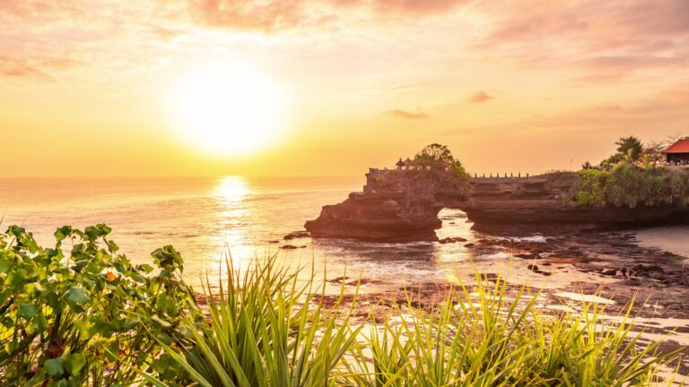 Tanah lot temple bali and rocky formation at the golden 7 scaled
