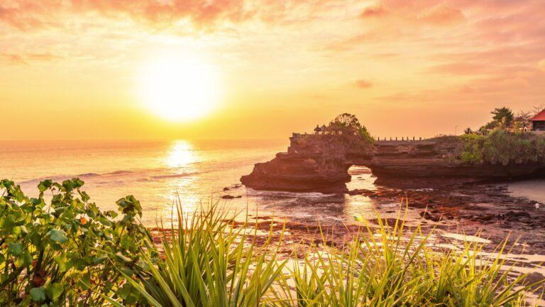 Tanah lot temple bali and rocky formation at the golden 8 scaled