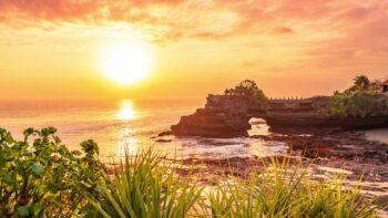Tanah lot temple bali and rocky formation at the golden 9 scaled
